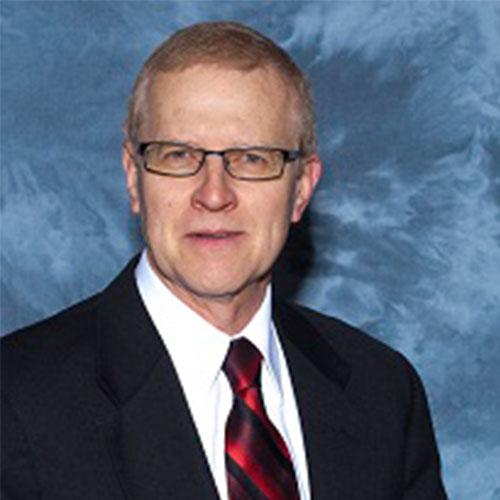Headshot of John D. Schuetze