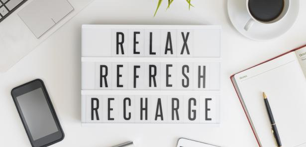 relax refresh recharge sign with phone and day planner