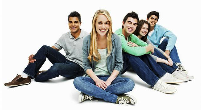 group of teens smiling at the camera