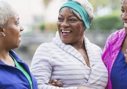 senior black women laughing together