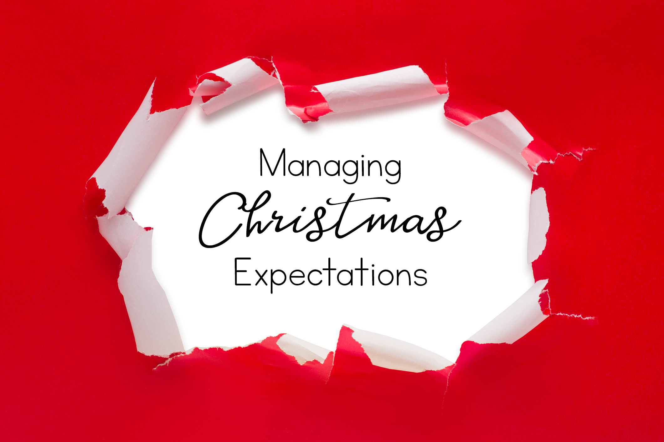 words Managing Christmas Expectations behind red wrapping paper