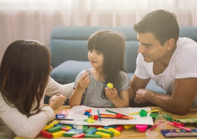 girl with two parents, using colorful play dough, ctss services