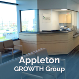 Appleton GROWTH group with picture of office in background