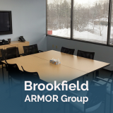 Brookfield ARMOR group with a table and chairs