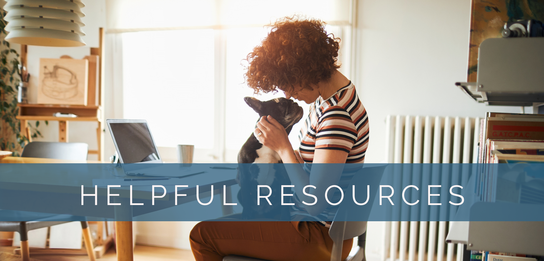 """image of a woman at a table with a dog in her lap with text overlaid that says """"Helpful resources"""""""