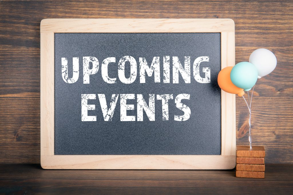 UPCOMING EVENTS. Chalkboard and colored balloons on a wooden background, christian counseling milwaukee.